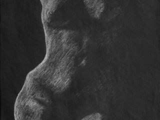 This live model exercise focused on using a strong light source to emphasize only one side of the figure leaving the other totally obscured in shadow. Chalk on Black Paper