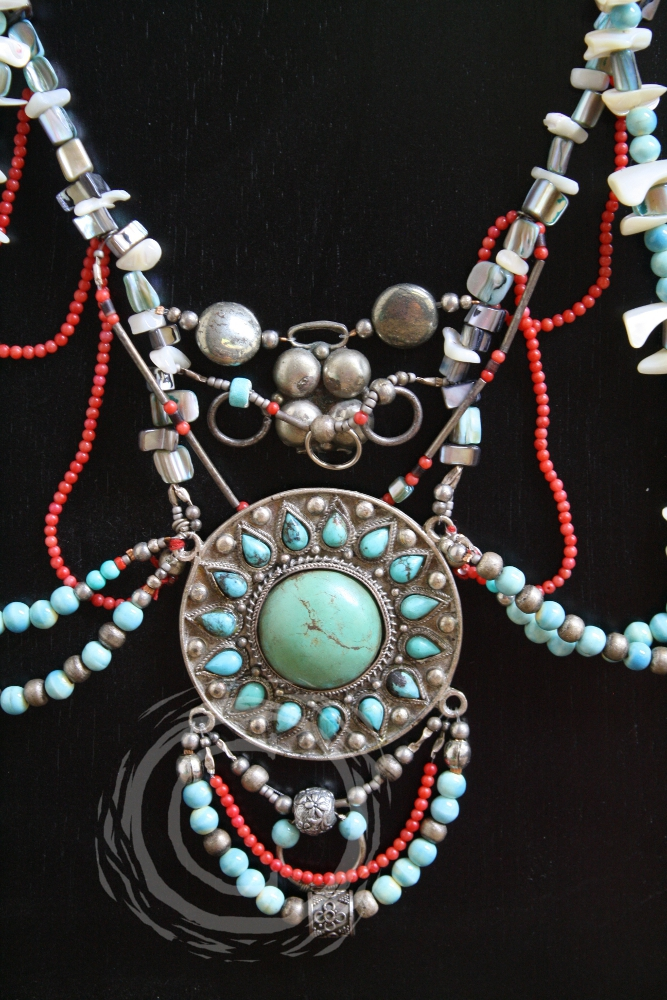This jewelry set combines shell, turquoise, coral, and silver beads in a semi-asymmetric design to create a stunning piece of wearable art. Includes necklace, earrings and bracelet.