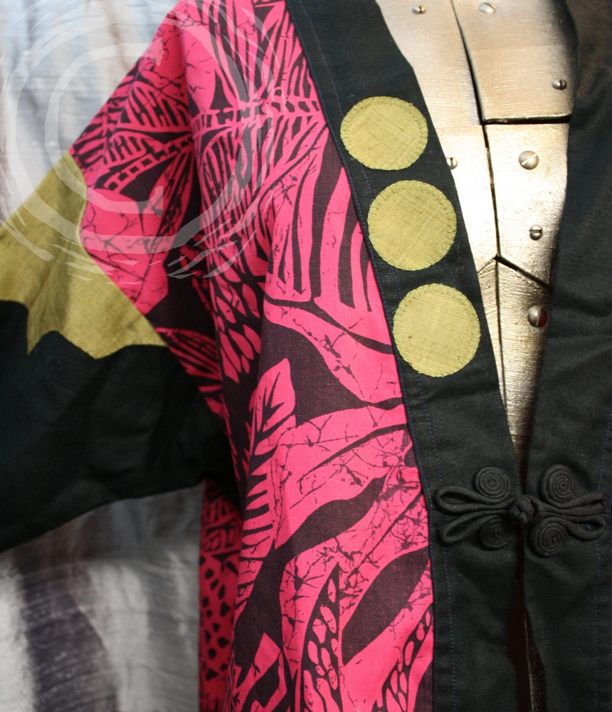 This Japanese style Haori coat used asymmetrically arranged gold appliques to accent the pink and black batik and black cotton of the rest of the coat.