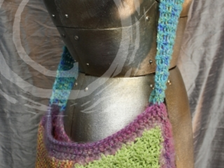 This bag is made from a variety of novelty yarns and utilizes both knit work and crochet.
