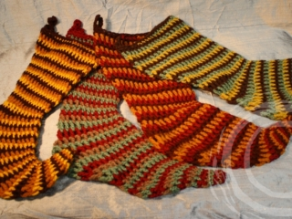 These hand crochet stockings were made using three vintage yarns simultaneously to create their striped pattern.