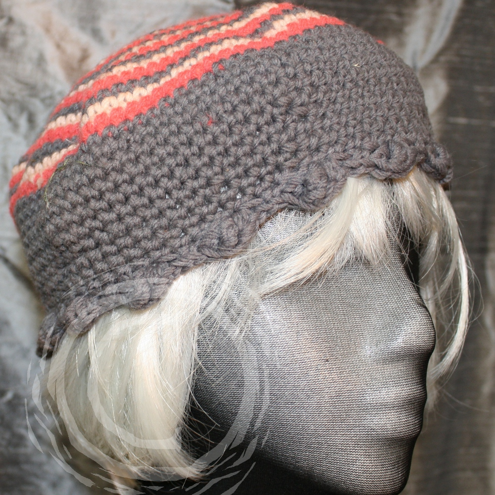This hand crochet hat uses a unique stitch pattern where three colors are crochet at once to produce spiraling stripes.