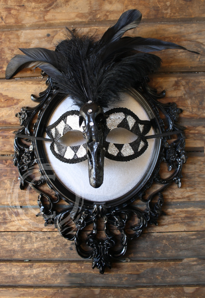 This mask is inspired by the Black Swan character in the ballet Swan Lake and is a wearable art piece.