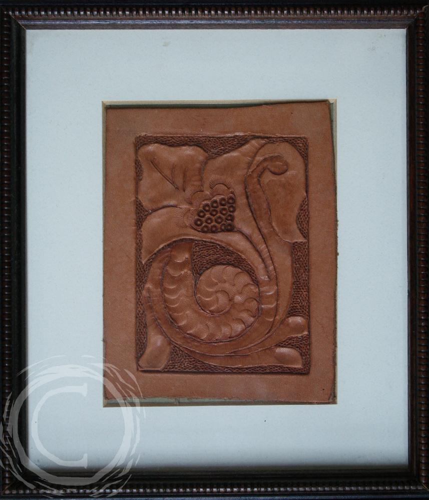 This leather tooling has a trumpet lily that can be mounted vertically or horizontally.