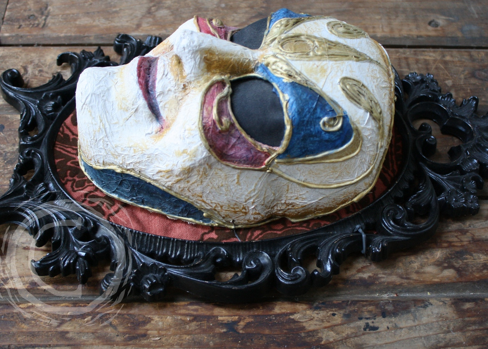 This mask is inspired by the British television show Dr Who and is a wearable piece similar to the masks on the Clockwork Men in the Madame de Pompadour episode.